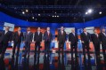 Republican presidential candidates arrive on stage for the Republican presidential debate on August 6, 2015 at the Quicken Loans Arena in Cleveland, Ohio. From left are:  New Jersey Gov. Chris Christie;  Florida Sen. Marco Rubio;  retired neurosurgeon Ben Carson; Wisconsin Gov. Scott Walker; real estate magnate Donald Trump; former Florida Gov. Jeb Bush; former Arkansas Gov. Mike Huckabee; Texas Sen. Ted Cruz; Kentucky Sen. Rand Paul; and Ohio Gov. John Kasich.  AFP PHOTO / MANDEL NGAN